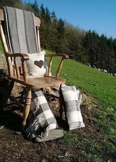 Chair on hill with wool blankets and cushion